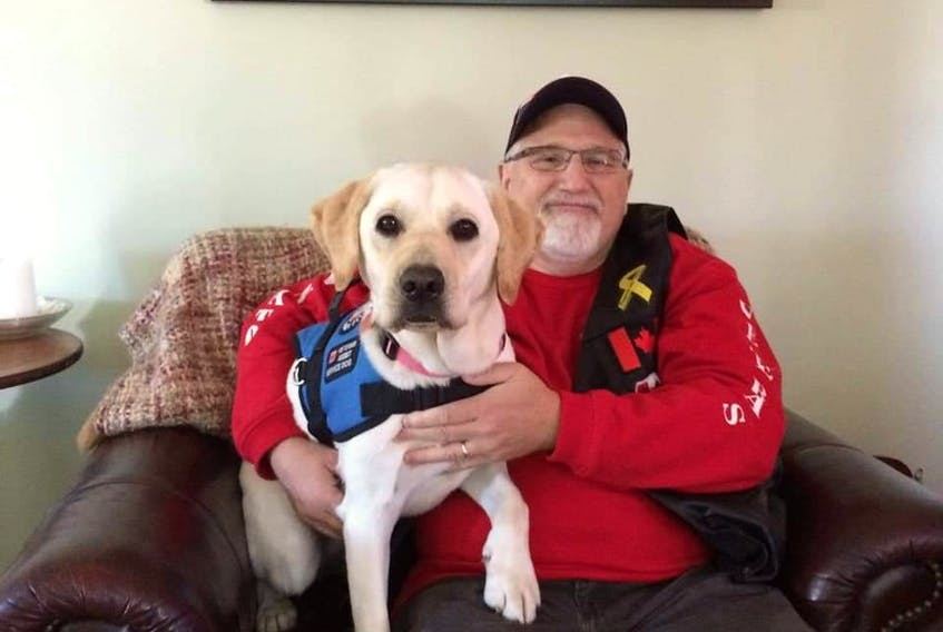 Roger and Mission make up a service dog team. -- Paws Fur Thought