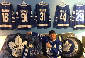 Bruce MacAulay of Glace Bay is shown in his Toronto Maple Leafs shrine and will be rooting for the blue and white in their playoff series with the Montreal Canadiens. MacAulay has been a Maple Leafs fan for more than 35 years. CONTRIBUTED