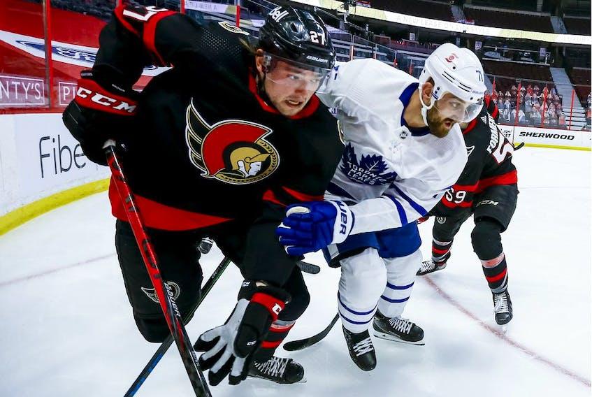File photo/ Ottawa Senators centre Logan Brown (27) and Toronto Maple Leafs left wing Nick Foligno (71) fight for position.