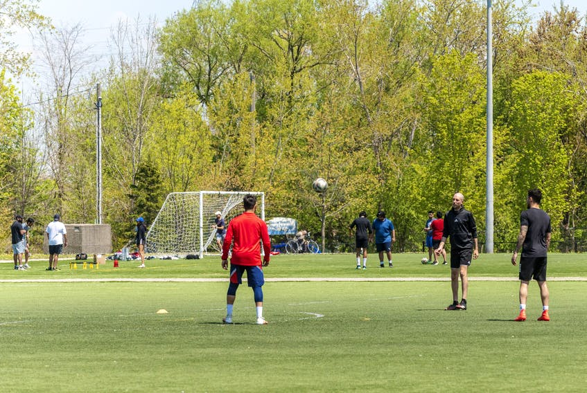 People play soccer at Cherry Beach in Toronto. Outdoor team sports remain banned everywhere in Ontario until at least June 14, while unorganized, unsafe, unmonitored sports can be played on any outdoor field or court, anywhere in the province.