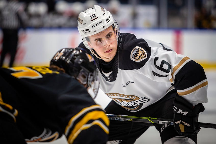 Charlottetown Islanders centre Pat Guay, right, prepares to take a faceoff in Game 3 of the Quebec Major Junior Hockey League semifinal on Friday. - Jonathan Roy - QMJHL
