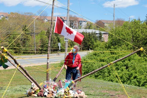 Wayne Hall, Assistant Group Commissioner for the Portland Estates Scouts checks on the status of the memorial site for five-year-old Max Thomas after Sunday's high winds. Thomas was a passenger in a vehicle which had a collision with a truck at the corner of Portland Estates Blvd. and Portland Street Friday evening. The boy succumbed to his injuries Saturday but was kept on life support so several of his organs and tissue could be donated to others. The impromtu memorial began as well-wishers planted flowers and toys next to the road., But the little boy's Beaver Scout group leaders created a 'floating flag pole' at half-mast to move it, make it more visible and to accommodate the overwhelming response of flower, notes and toys from the community.