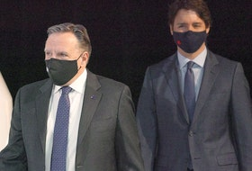 Quebec Premier Francois Legault and Prime Minister Justin Trudeau arrive at a news conference in Montreal, on Monday, March 15, 2021.