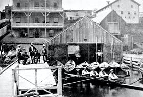 The internationally famous oarsmen known as the Pryor Crew, all seated in shell, at the Royal Halifax Yacht Club, then located on the Halifax waterfront, in an area which is now part of the Halifax Shipyards. August 1871. - Nova Scotia