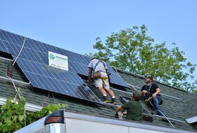 A crew from Renewable Lifestyles install solar panels on the roof of a Charlottetown home in August 2020. With new funding, residents in Charlottetown, Stratford and Wolfville, N.S., can have the upfront costs for energy-efficient retrofits like this covered by their municipality.