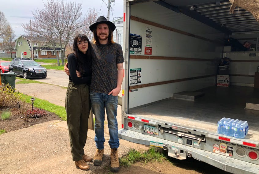 Anne Dennis and Gianni Rizzetto stand beside the U-Haul they rented last week to move their belongings after feeling intimidated by their landlord and his employees in what the couple considered an illegal eviction from their Sydney rental unit. NICOLE SULLIVAN/CAPE BRETON POST