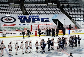 The Winnipeg Jets shake hands with the Edmonton Oilers following their victory in Game 4 of the first round of the 2021 Stanley Cup playoffs on May 24, 2021, at Bell MTS Place in Winnipeg.