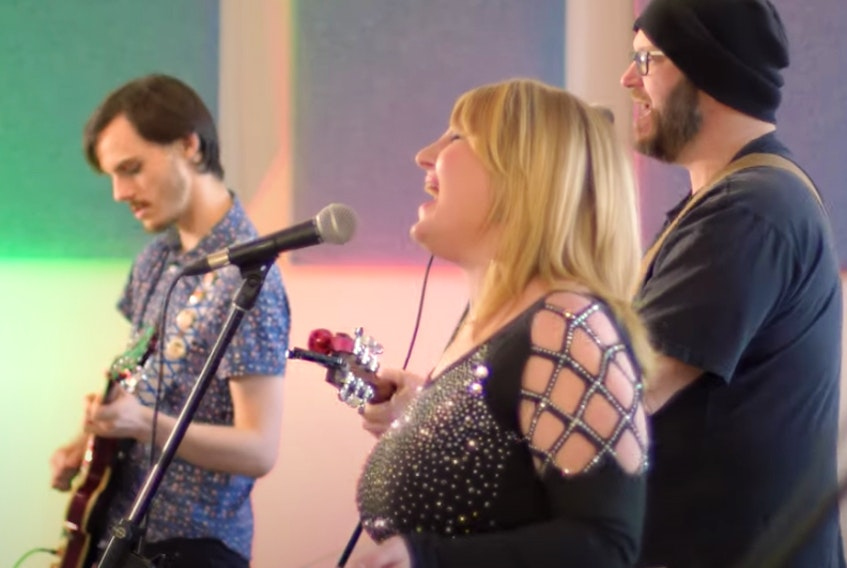 """From left to right, Nik MacDonald, Erin O'Brien and Steve MacIntyre of Suite 115 perform the song """"We'll Be Together Again."""" They're students of Nova Scotia Community College's music arts program. CONTRIBUTED"""