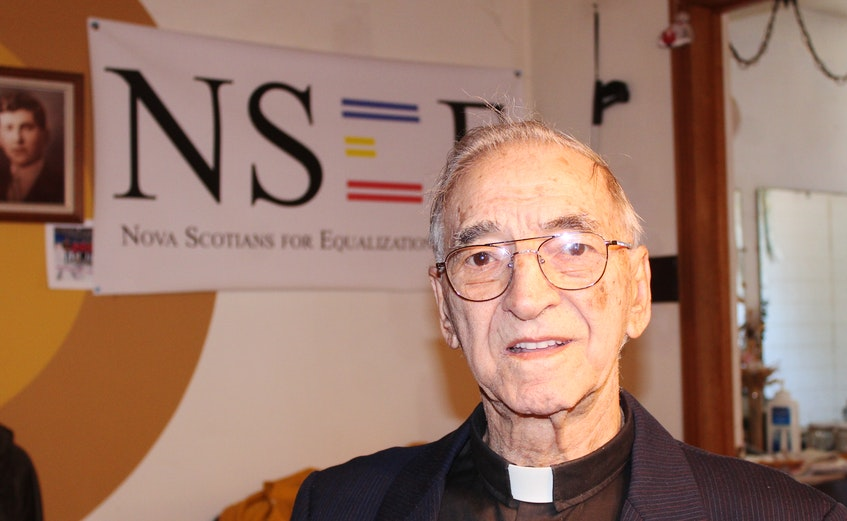 At age 90, Father Albert Maroun -- shown at his Sydney office -- continues to keep busy as a priest whenever needs arise around the Cape Breton Regional Municipality. -- IAN NATHANSON/CAPE BRETON POST - Ian Nathanson
