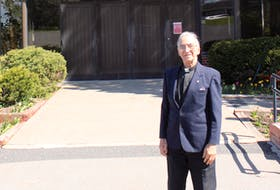 Father Albert Maroun, standing outside of Our Lady of Fatima church in Sydney River, is set to celebrate 60 years of being ordained as a priest on Thursday. -- IAN NATHANSON/CAPE BRETON POST