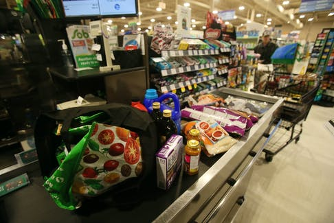 A customer at the checkout at the Sobeys grocery store on Windsor Street in Halifax. Self-checkouts have become increasingly popular during the pandemic. TIM KROCHAK - The Chronicle Herald