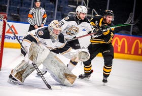 Charlottetown Islanders defenceman Sean Stewart, a former Cape Breton West Islander, battles with Victoriaville Tigres forward Zachary Gravel while Isles goalie Colten Ellis concentrates on the puck during Quebec Major Junior Hockey League semifinal action in Quebec City this week. The Islanders were eliminated from the playoffs by the Tigres on Tuesday night. Contributed • Jonathan Roy