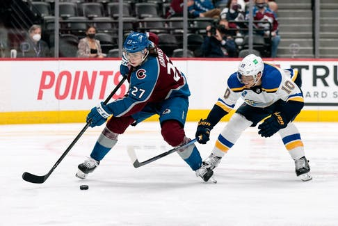 Colorado Avalanche defenceman Ryan Graves (27) controls the puck under pressure from St. Louis Blues center Brayden Schenn (10) in Game 2of the first round of the 2021 Stanley Cup Playoffs at Ball Arena in Denver.