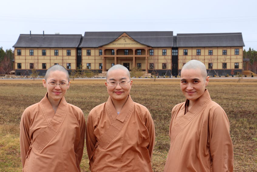 Venerables Joanna, left, Sabrina and Yvonne are nuns at the Great Wisdom Buddhist Institute in Brudenell.