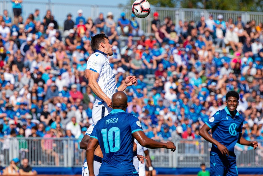FC Edmonton defender Amer Didic (55) jumps for a header against HFX Wanderers FC attacker Luis Perez (10) in this file photo from Sept. 28, 2019, in Halifax, N.S.
