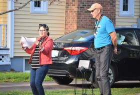 Anne and Dave Murphy begin the neighbourhood sing-along on Hampstead Court May 13. It's an activity they organized last year during the COVID lockdown as well.