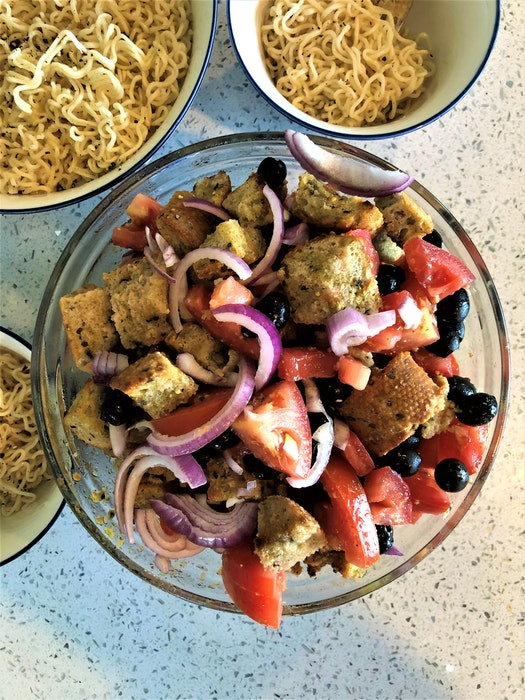 An inexpensive version of panzanella salad featuring discounted bread and vegetables. - Mark DeWolf