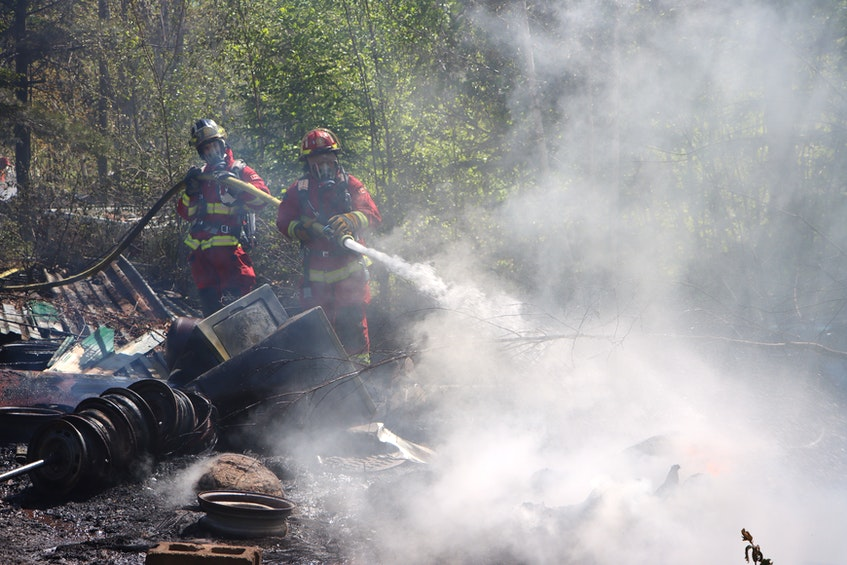 Firefighters had their work cut out for them when they had to battle a junkyard fire in a location that was difficult to access near Canaan Road in Nicholsville on May 25. – Adrian Johnstone - Contributed