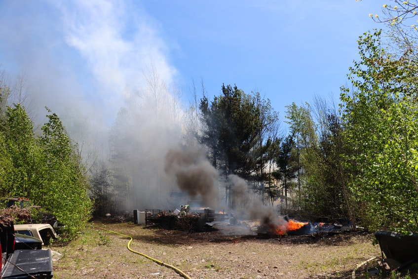 The cause of the junkyard fire in Nicholsville, Kings County is unknown. – Adrian Johnstone - Contributed