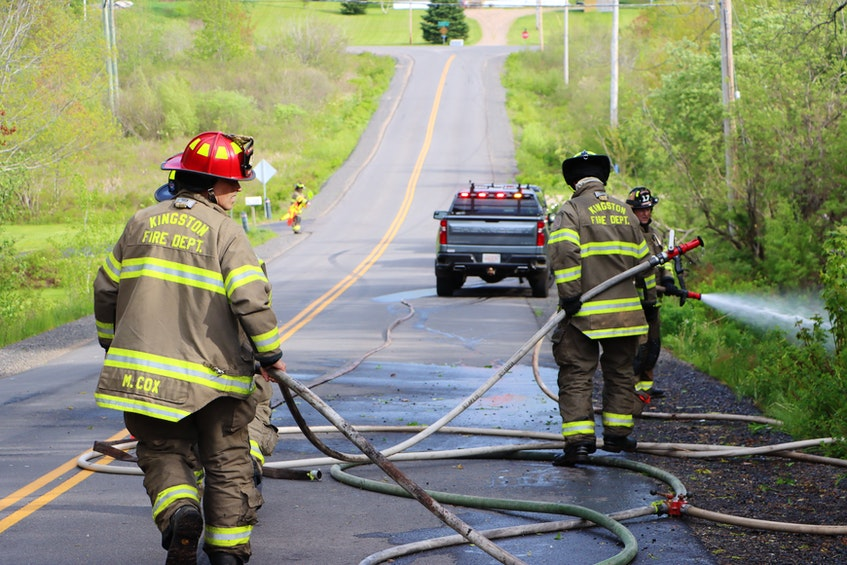 Kingston's firefighters make short work of a small woods fire that broke out along Greenwood Road. – Adrian Johnstone - Contributed