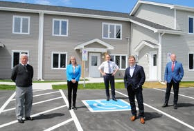 Pictured outside the new NLHS social housing units on Froude Avenue following an announcement on social housing funding Friday, May 28, are, from left, Fraser Piccott, chair of the Board of Directors of the Froude Avenue Community Centre, Julia Mullaley, CEO, NLHC, federal Natural Resources minister Seamus O'Regan, Newfoundland and Labrador Premier Andrew Furey and John Abbott, N.L. minister responsible for the NLHC.