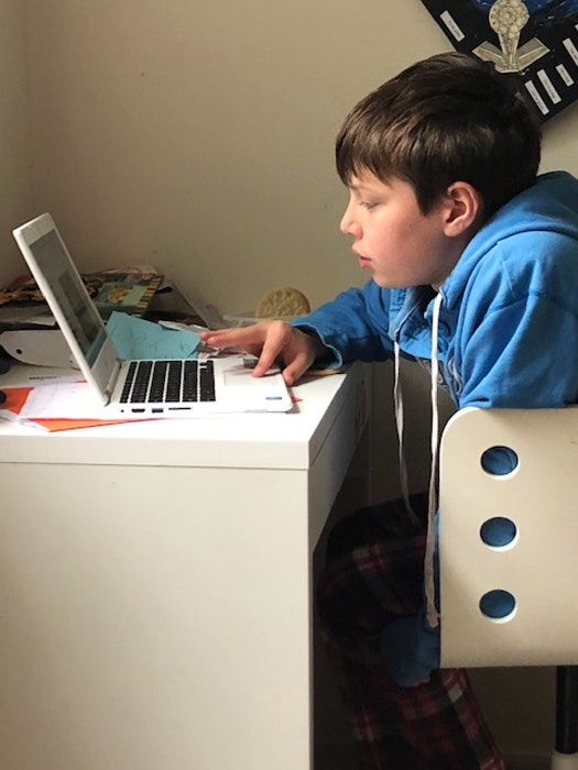 Logan MacLean, a Grade 5 student, learning from his home in HRM. His mother Roxanne MacLean said working and homeschooling is a difficult juggle and she feels she's constantly falling behind. - contributed