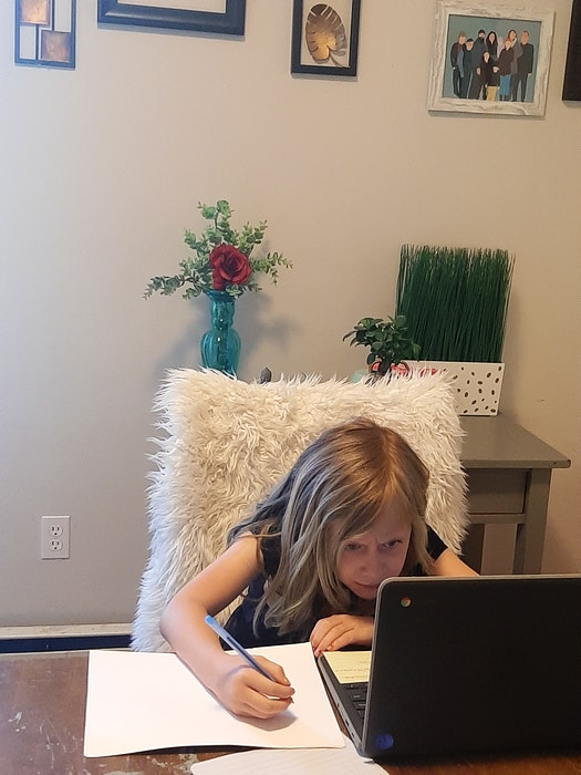 Nicole Matthews' daughter Londyn, 8, hard at work homeschooling in their home in Bedford. - Contributed