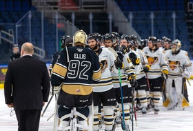 The Charlottetown Islanders and Victoriaville Tigres shake hands after finishing their best-of-five Quebec Major Junior Hockey League semifinal Tuesday in Quebec City. Victoriaville won the series 3-2.