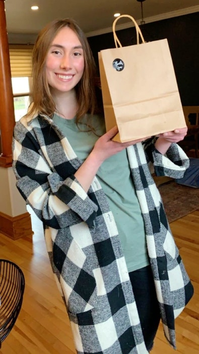 Cela MacLellan, 17, holds one of the care packages she delivered to workers at the Membertou COVID-19 assessment centre earlier this month. She was one of the volunteers for the nationwide youth-driven initiative called Supporting Real Life Heroes. CONTRIBUTED  - Contributed