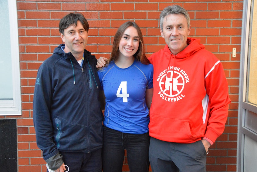 Cela MacLellan, centre, stands with her father Neil, left, and uncle James. The 17-year-old Sydney Academy student, who has committed to play volleyball for Mount Saint Vincent University next year, wanted to give back to front-line workers and thought volunteering with Supporting Real Life Heroes was a good way to do that. FILE PHOTO/CAPE BRETON POST.