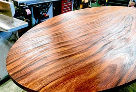 Finishing or refinishing a tabletop is one of the most demanding finishing tasks because the results are seen so closely. Steve finished this acacia wood tabletop using oil and a power buffing process.