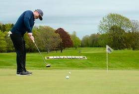 """Mark Carragher practises his putting before a round Thursday at the Belvedere Golf Club in Charlottetown. """"Golf is about confidence,"""" he said. """"If you're confident, you're probably going to play well."""""""