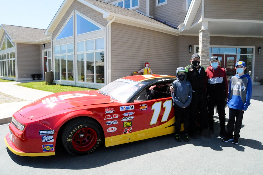 ]Driver Phil Fowler is shown with Ronald McDonald House residents Austin Kelly-Hewitt of King's Point (left), Aiden O'Keefe of Happy Valley-Goose Bay (second from right) and Connor Butt of Stephenville. — Joe Gibbons/The Telegram