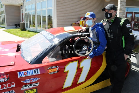In a sunny Friday afternoon outside the Ronald McDonald House Charities of Newfoundland and Labrador (RMHC-NL) on Clinch Crescent, three young boys, currently patients there, were able to enjoy the feeling of sitting in a  NASCAR 2013 Camaro racing car. RMHNL has teamed up with Phil Fowler Racing that will see the racing team promote and fundraise for the charity for a three-year racing season at the Eastbound International Speedway in Avondale. Fowler will participate in the first (100 lap) race of the 2021 season this Sunday afternoon at 2 p.m. around the oval track.In 2016 Fowler competed at Orlando Speedway's INEX Winter Nationals event. In 2020 Fowler captured his first championship title at Thunder Valley Speedway. Above, Fowler is shown with RMHC-NL patient Connor Butt, 11, of Stephenville on the province's west coast. -Joe Gibbons/The Telegram