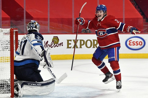 Montreal Canadiens'  Cole Caufield  celebrates a goal by teammate Artturi Lehkonen against Winnipeg Jets goalie Connor Hellebuyck during an NHL game on May 1.  Eric Bolte-USA TODAY Sports