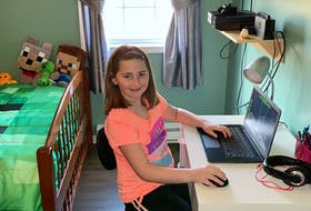Eight-year-old Adrianna Deveaux loves going to school, but says she is adapting to learning from home. CONTRIBUTED
