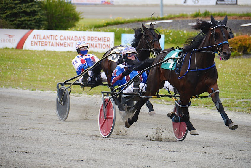 Sports Report with Jason Hughes driving, right, won Race 2 in 2:00.3 at Red Shores at the Charlottetown Driving Park.