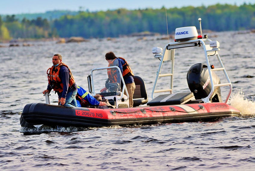 Firefighters from Kentville and New Minas teamed up to rescue two paddlers after a canoe overturned on Gaspereau Lake Friday evening. – Adrian Johnstone