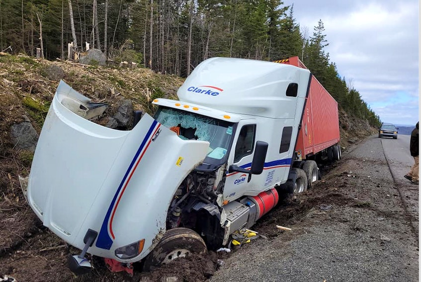 A transport truck in a ditch following a single-vehicle accident by the Englishtown exit on Highway 105 in Victoria County, Monday. -- FACEBOOK