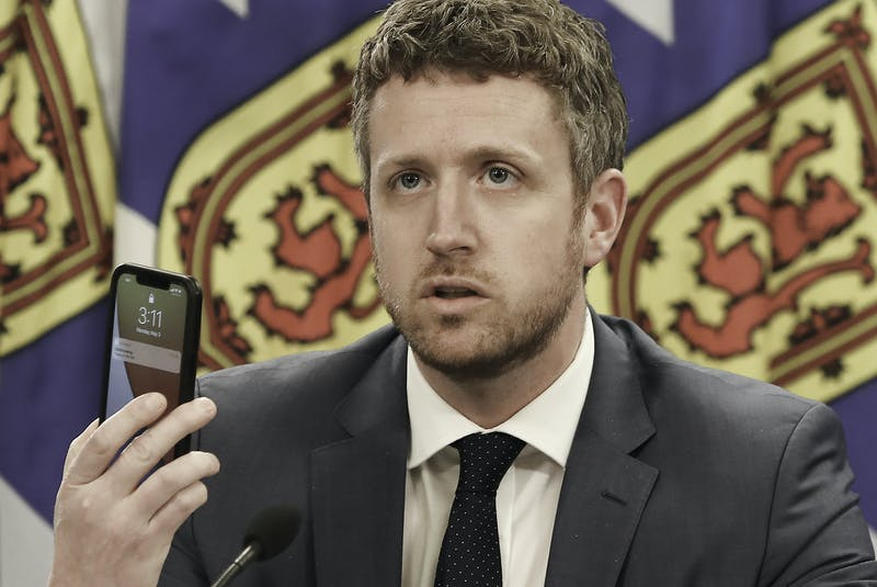 May 3, 2021 - Nova Scotia Premier Iain Rankin holds up a cellphone while asking young people to research the effects of the variants of COVID-19 during an online update on the state of the pandemic in the province on Monday, May 3, 2021. - Communications Nova Scotia
