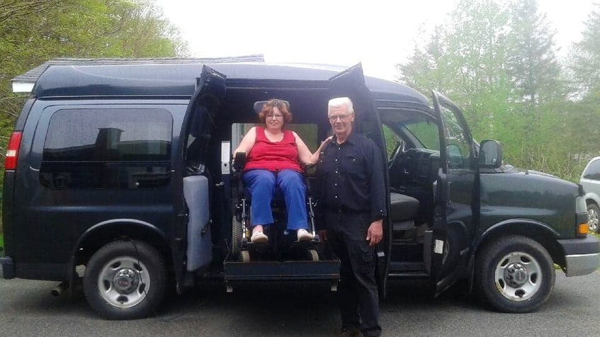 This navy blue wheelchair-accessible van has helped four P.E.I. families since it was purchased in 2017, including Donald Constable, right, who donated it to Ida McCourt and her sister in 2020. - Contributed