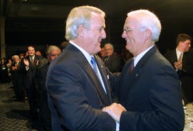 Former prime minister Brian Mulroney, left,  is greeted by former Nova Scotia premier Donald Cameron at a $500-a-plate fundraising dinner for the Progressive Conservative Party in Halifax in 2002.