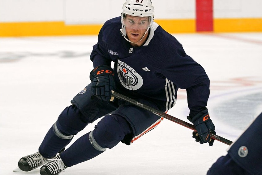 Edmonton Oilers captain Connor McDavid led the NHL in points entering Monday's play. He had 87 while his teammate, Leon Draisaitl, was second with 71.