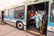 Health-care workers conduct rapid COVID-19 screening on a city bus in the Waterloo Region Friday. The rollout of rapid testing in Canada has been slow, but that is changing.