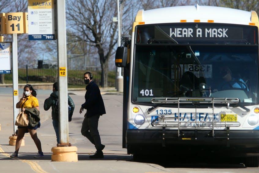 FOR NEWS: Halifax Metro Transit passengers disembark from a bus a the Bridge Terminal in Dartmouth Monday May 3, 2021.  TIM KROCHAK PHOTO
