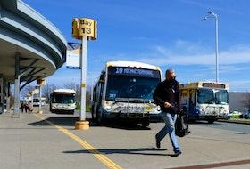 FOR NEWS: A commuter dashes towards their bus at the Halifax Metro Transit Bridge Terminal in Dartmouth Monday May 3, 2021.  TIM KROCHAK PHOTO