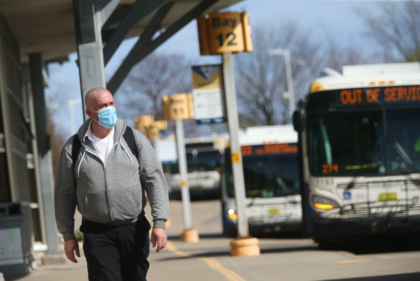 FOR NEWS: A commuter heads towards their bus at the Halifax Metro Transit Bridge Terminal in Dartmouth Monday May 3, 2021.  TIM KROCHAK PHOTO