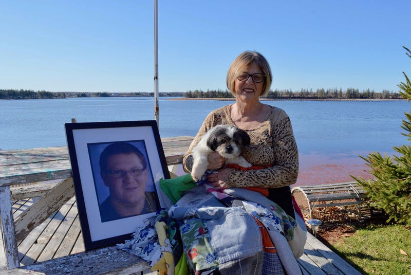 Nancy Williams sits with Kylar's old dog, Max. - Alison Jenkins