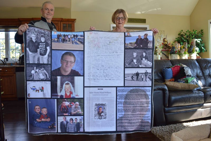 Williams and Terweeme hold the fleece blanket made in memory of Kylar. - Alison Jenkins