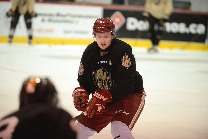 Acadie-Bathurst Titan defenceman Cole Larkin skated with his former major under-18 team, the Charlottetown Bulk Carriers Knights, at the Eastlink Centre when he was home for Christmas.